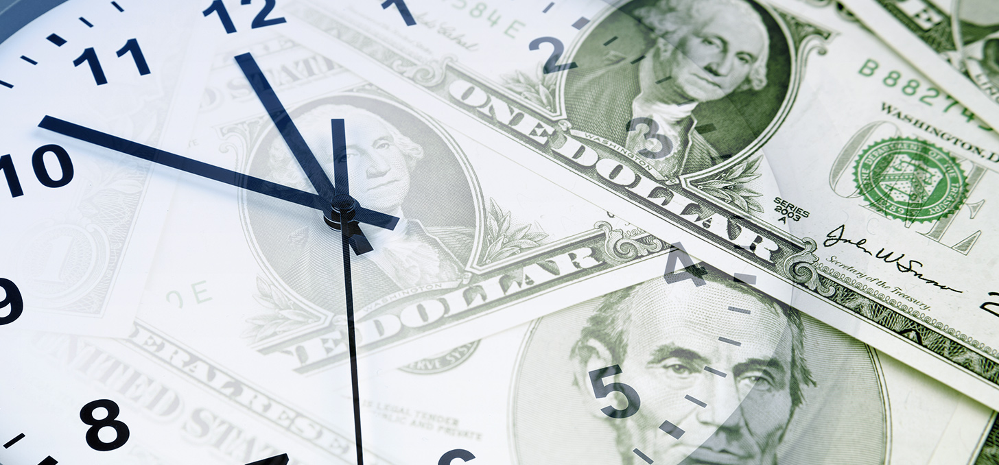 A clock and cash representing an increase in your savings over time.